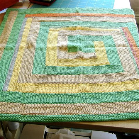 log cabin style knitted baby blanket greens and