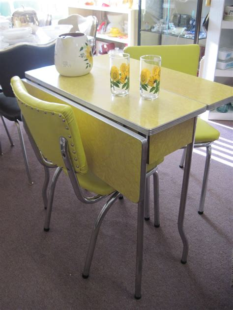 yellow 1950 s cracked formica table and chairs