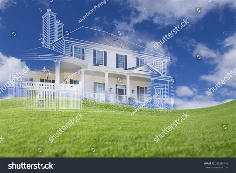 the value of your house over and above the mortgage beautiful custom house drawing and ghosted house above grass field stock photo