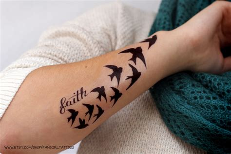 demi lovato shows off new faith n birds tattoo on arm