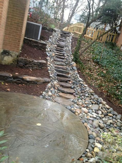 create a sturdy yet attractive walkway on any slope with stone and gravel repin if this path