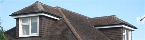 dormer at peak of roof hip roof with dormers