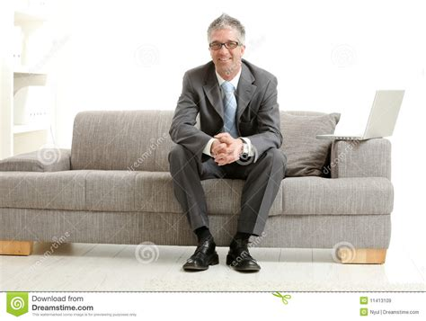 sitting couch businessman sitting on couch royalty free stock images