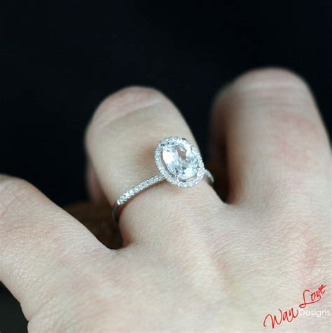 white topaz oval cut halo engagement by