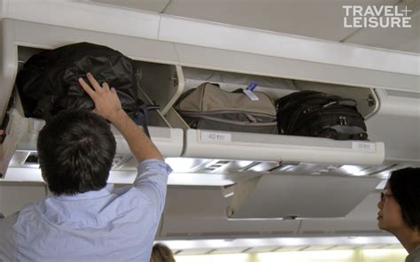 how many carry on bags allowed united the right way to put your luggage in the overhead bin on a