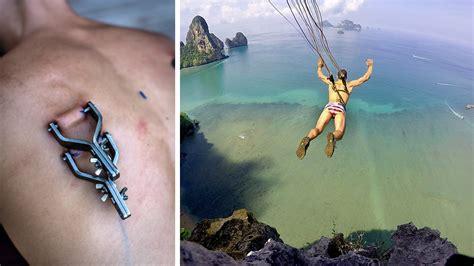 back tattoo man jumping off building suspension base jumping jpg
