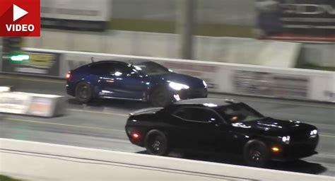 Hellcat Charger Vs Tesla by Tesla Model S P100d Vs Dodge Challenger Hellcat Is Nail