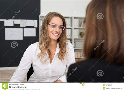 Office Mate by Happy Pretty Office Talking To Office Mate Stock