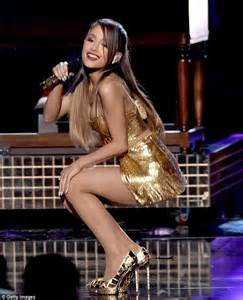 Ariana Grande Sizzles In Gold Stilettos At The Amas