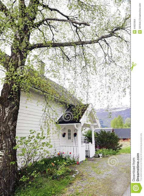 small house whiteangel small white house with front wood porch stock photo