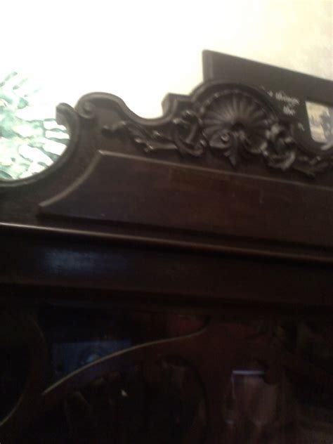 I Have An Antique China Cabinet  Think It Is 1920 To 1930. Has Wooden Whe    My Antique