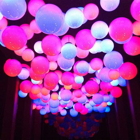 floating neon balloons on the ceiling from last night