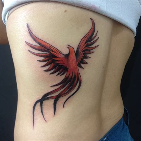 phoenix tattoo on side black and red flying phoenix tattoo on side