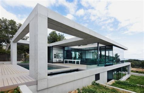 glass and concrete house marvelous house featuring concrete exterior and glass