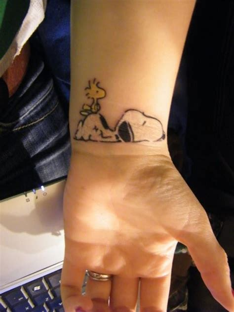 snoopy tattoo designs snoopy designs ideas and meaning tattoos for you