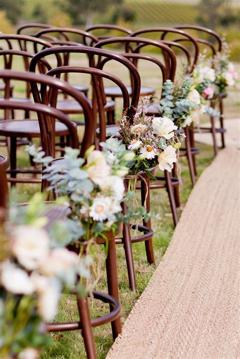 Like these wooden chairs with a little clump of flowers