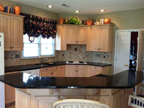 light oak wood kitchen cabinets verde butterfly granite countertops white cabinets