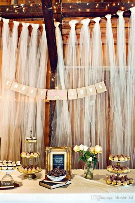 Easy DIY tulle buffet backdrop wedding decoration.   DIY