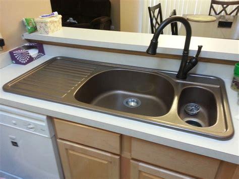 kitchen sink with drainboard corstone kitchen sink with attached drainboard in cinnabar