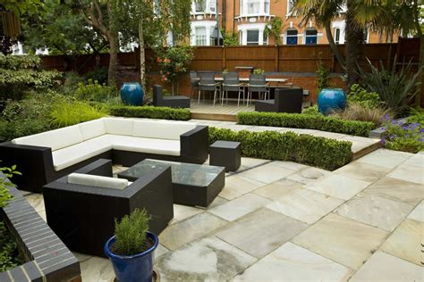 large paved garden terrace with sunken paved area and