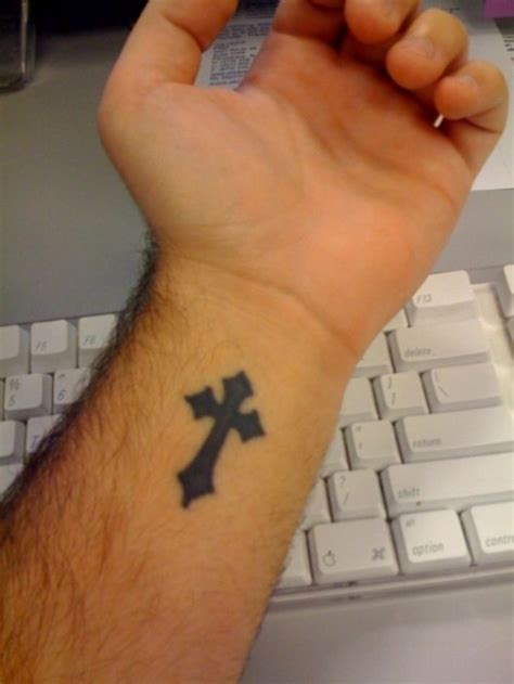 cross tattoo on your wrist cross wrist tattoos for guys