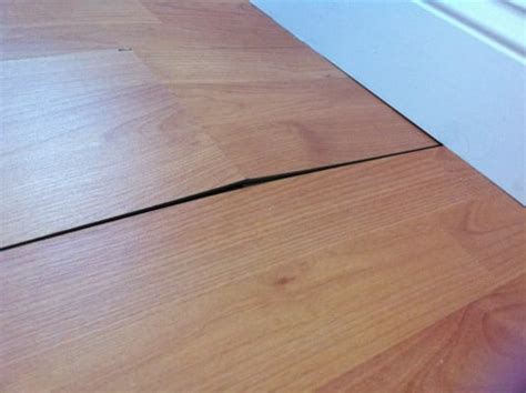 buckling cheap laminate floor yelp