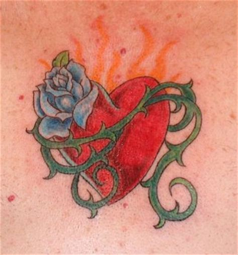 tattooed heart composer tattoos by designs heart tattoo meanings and pictures