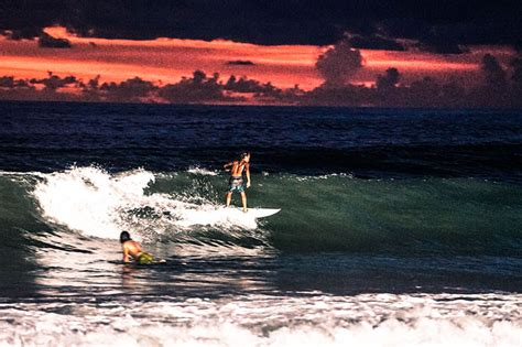 surfing  lights  happy hour nightly  finns beach