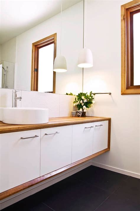 Wood vanity top bathroom contemporary with double sink mount vessel faucets