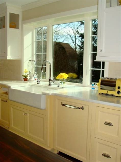 kitchen cabinets over sink window window over sink basin sink and yellow kitchens on