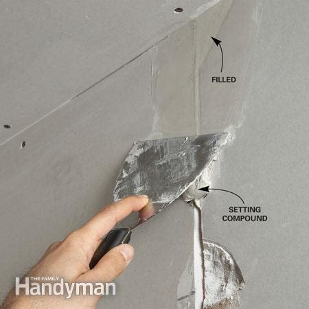 how to put photos on wall without tape drywall taping tips the family handyman