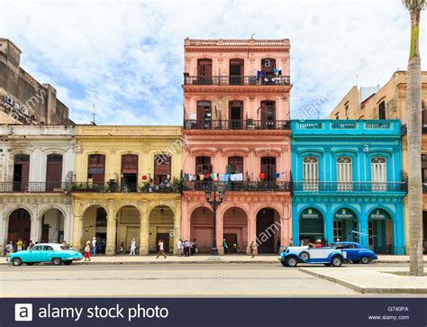 how to buy a house in cuba havana street scene classic cars and colorful houses in paseo de stock photo