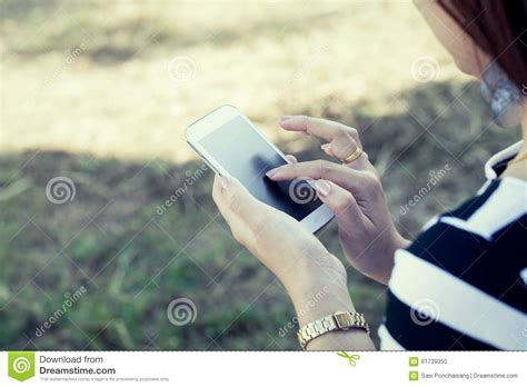 asian businessman using mobile phone or tablet pc at white