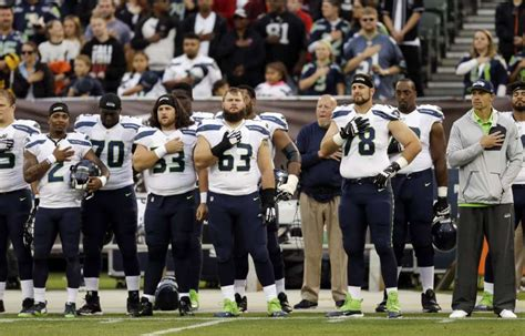 football link seahawks will stand link arms in pregame demonstration