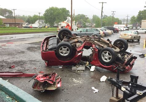 car crash firefighters free driver after car crashes through pole flips in mattydale syracuse