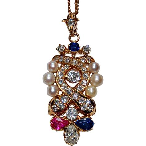 Jeweled Pendant antique jeweled pendant ruby pearls sapphires 14k