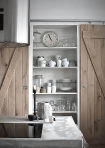 Kitchen with double sliding barn doors to larder or pantry
