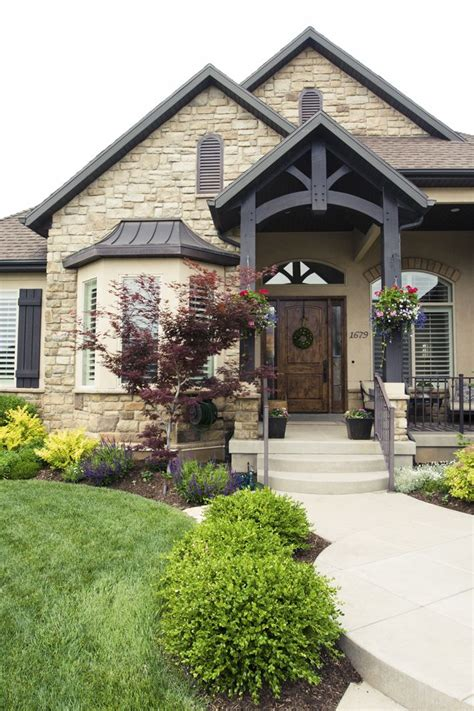 everything about this exterior the beams the the exterior paint the railing