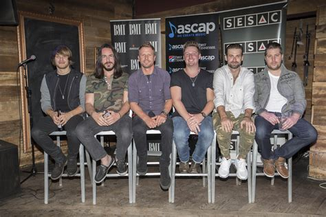 dierks bentley and songwriters celebrate somewhere on a