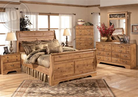 bittersweet light brown king sleigh bedroom set