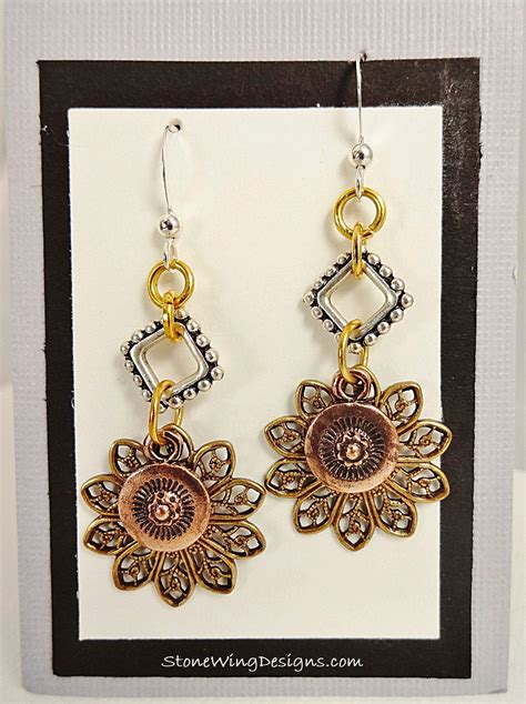 mixed metal earrings copper gold silver by encantodesign mixed metal earrings with gold filigree copper charm and