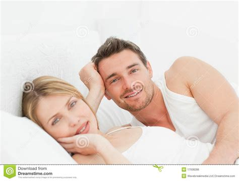 lying down in bed lovely pairs lying down together in their bed royalty free stock image image 17938286