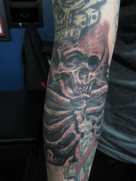 ditch tattoo skull in the ditch by mathew delamort tattoonow