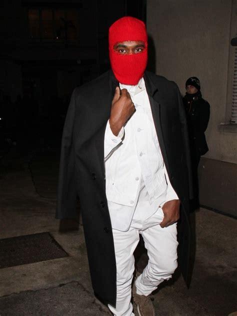wtf alert tis wifes permanent eye color change gossip kanye west wears red ski mask to margiela paris fashion
