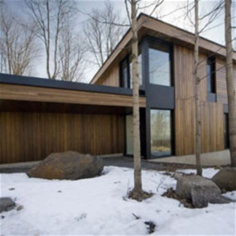linear mountain house of wood glass and chalet charm stone mountain chalet with elevator and ski room