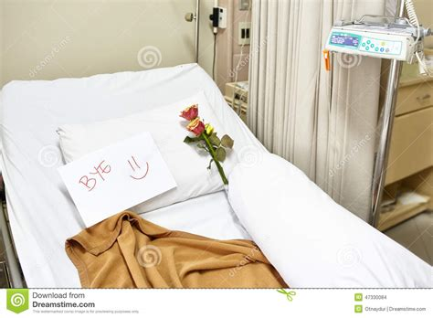 empty hospital bed after recovery