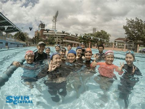 swim central students with coach mark compass by haifa