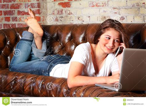 couch girls typical teen communications royalty free stock photography