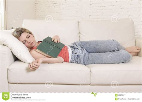 sleep in couch young beautiful caucasian woman sleeping while reading