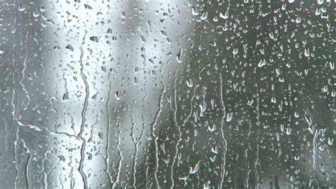 rain falling  glass  stock footage video